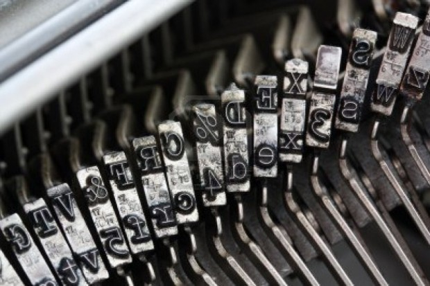 10256452-line-of-typebars-on-an-old-typewriter-1024x683